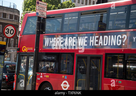 London, Kings Cross. Red double decker bus with 'Where are we heading ?' written on it. - Stock Photo