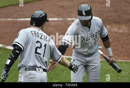 Chicago White Sox Austin Jackson (10) is congratulated by teammate Todd Frazier after scoring against the Baltimore Orioles on a single by Jose Abreu during the fifth inning at Camden Yards in Baltimore, May 1, 2016. Photo by David Tulis/UPI - Stock Photo