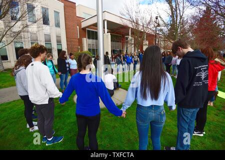 Grants Pass High School students participate in a prayer circle during a national walkout to honor Florida school shooting victims, in Grants Pass, Oregon, March 14, 2018. The youth-organized protest brought attention to school safety, protested gun violence, and honored the 17 victims of the shooting at Marjory Stoneman Douglas High School. Photo by David Tulis/UPI - Stock Photo