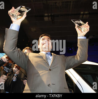 Mark Fields, Ford Motor Company, President, The Americas, holds up the awards for the 2010 North American Car and Truck of the year at the North American International Auto Show at the COBO Center on January 11, 2010 in Detroit, Michigan. Ford won both top awards for the 2010 Ford Transit Connect truck and the 2010 Ford Fusion Hybrid car.      UPI/Brian Kersey - Stock Photo