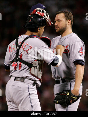 Cleveland Indians starting pitcher Jake Westbrook (R) chats with catcher Victor Martinez in the first inning of game seven of the American League Championship Series against the Boston Red Sox at Fenway Park in Boston on October 20, 2007. (UPI Photo/Matthew Healey) - Stock Photo