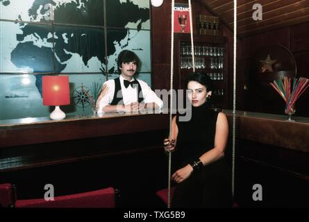 The Hafenbar (harbour bar) opened in East Berlin in 1967 in a maritime atmosphere: painted portholes, fishing net, illuminated world map, sawfish head and stuffed alligator. Thursday night was Ladies Night, Women only. 1982 - Stock Photo