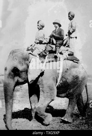 George V, King of the United Kingdom from 1936. Riding on an elephant on a hunting trip in Nepal on december 1911, while in India to be installed as King-Emperor of India. - Stock Photo
