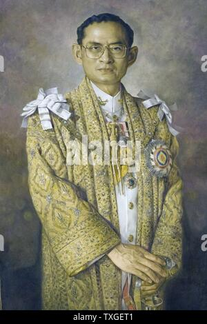 Portrait of Rama IX Bhumibol Adulyadej (1927-) King of Thailand and ninth monarch of the Chakri Dynasty, in ceremonial attire. Dated 1967 - Stock Photo