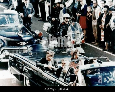 President John F Kennedy in the presidential limousine before his assassination. His wife Jacqueline is next to him and Texas Governor John Connally and his wife Nellie sit in front. - Stock Photo