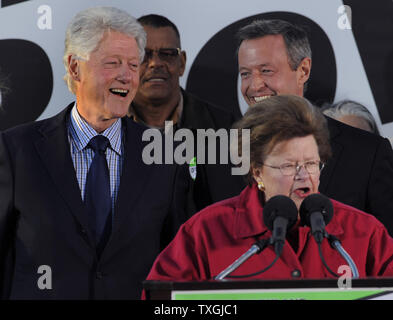 Former U.S. President Bill Clinton (L,background) smiles with Maryland Gov. Martin O'Malley as Sen. Barbara Mikulski (D-MD) makes remarks, at Federal Hill Park,in Baltimore, Maryland, October 21, 2010.  Clinton has been lending a hand on the campaign trail, as some polls suggest the Democrats may lose majority control of the House in the upcoming midterm elections.        UPI/Mike Theiler - Stock Photo
