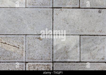 Concrete tile texture. City pavement background. Abstract stone brick pattern. Street sidewalk texture.