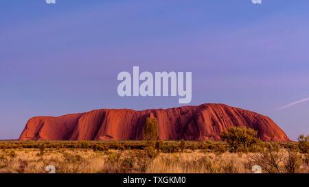 Beautiful and colorful sunrise over Uluru, Ayers Rock, Australia - Stock Photo