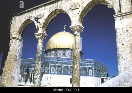 Jerusalem - The Dome of the Rock. Oldest existing Muslim monument, built 685-691 as a shrine for pilgrims. The Rock sacred to Muslims as site from which Muhammad ascended to heaven, and to Jews as place where Abraham prepared to sacrifice Isaac, his son. Photograph. - Stock Photo