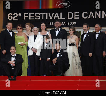 The crew from the film 'Up' arrive at the top of the red steps before a screening of their film at the opening of the 62nd annual Cannes Film Festival in Cannes, France on May 13, 2009.   (UPI Photo/David Silpa) - Stock Photo