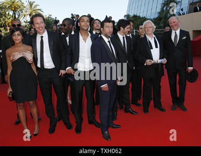 The crew from the film  'Un prophete' arrives on the red carpet before a screening of their film at the 62nd annual Cannes Film Festival in Cannes, France on May 16, 2009.   (UPI Photo/David Silpa) - Stock Photo