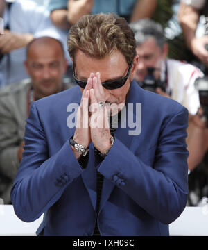 Rocker and actor Johnny Hallyday gestures at a photocall for the film 'Vengeance' at the 62nd annual Cannes Film Festival in Cannes, France on May 17, 2009.   (UPI Photo/David Silpa) - Stock Photo