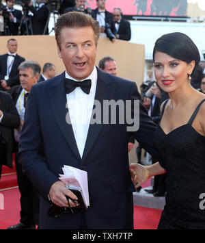 Alec Baldwin (L) and Hilaria Thomas arrive on the red carpet before the screening of the film 'Moonrise Kingdom' during the opening night of the 65th annual Cannes International Film Festival in Cannes, France on May 16, 2012.  UPI/David Silpa - Stock Photo