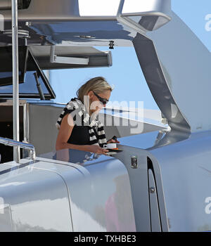 Sharon Stone departs from Roberto Cavalli's yacht docked next to the Palais des Festivals during the 66th annual Cannes International Film Festival in Cannes, France on May 21, 2013.   UPI/David Silpa - Stock Photo