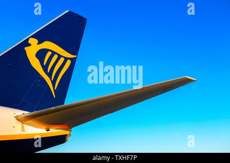 Alicante, Spain - June 18, 2019: Ryanair logo on the tail of aircraft plane - Stock Photo