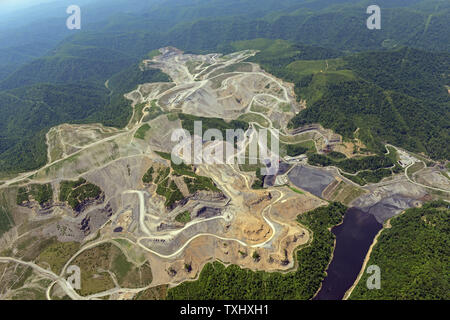 An aerial photo shows a mountaintop removal site and sludge pond in southern West Virginia, where mountaintops are blasted off to expose multiple seams of coal, May 26, 2013. The sludge pond is man-made for storing toxic sludge from coal mining operations. The United Nations Working Group on Business and Human Rights are calling for an investigation into alleged human rights abuses related to mountaintop removal, where toxic waste from the blasted mountains is dumped into streams, pollutes the air and threatens the health of local communities.    UPI/Debbie Hill - Stock Photo