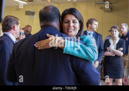South Carolina Governor Nikki Haley hugs members of the clergy before holding a press conference to announce the capture of the suspect who allegedly murdered nine people at historic Mother Emanuel African Methodist Episcopal Church in Charleston, South Carolina on June 18, 2015.  Photo by Gillian Ellis/UPI - Stock Photo