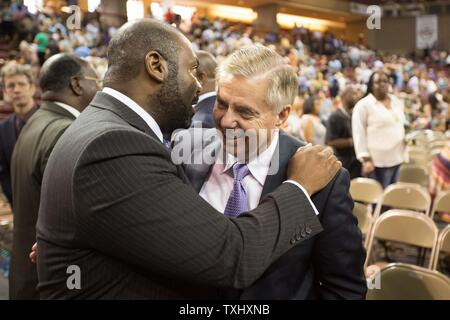U.S. Senator Lindsey Graham (R-SC), right, attends a vigil for the nine people shot and killed inside Emanuel African Methodist Episcopal Church was held at TD Arena in Charleston, South Carolina on June 19, 2015. The victims were killed on June 17, 2015. A suspect, Dylann Roof, 21, was arrested in connection with the shootings. Photo by Kevin Liles/UPI - Stock Photo