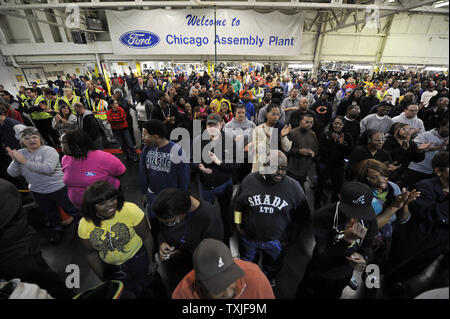 Workers at Ford's Chicago Assembly Plant listen as Ford and United Auto Workers Union executives speak on December 1, 2010 in Chicago. Ford spent nearly $400 million to renovate its Chicago facility to produce the all-new 2011 Explorer along with the Taurus and MKZ.     UPI/Brian Kersey - Stock Photo