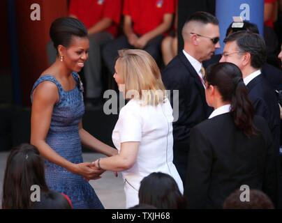 U.S. First Lady Michelle Obama is greeted by Chilean First Lady Cecilia Morel  after speaking on the importance of education at a High School in Santiago, Chile, March 21, 2011.  UPI/Jorge Peralta - Stock Photo