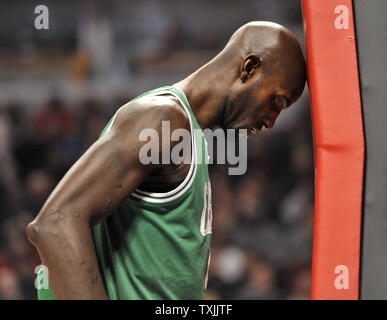 Boston Celtics forward Kevin Garnett bangs his head against the stanchion before the start of the game against the Chicago Bulls at the United Center on February 16, 2012 in Chicago. The Bulls won 89-80.    UPI/Brian Kersey - Stock Photo