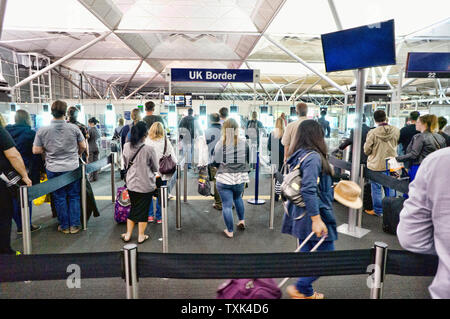 Passengers entering the UK from Stanstead Airport - Stock Photo