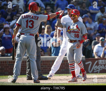St. Louis Cardinals Kolten Wong (16) celebrates with Matt Carpenter (13) after scoring against the Chicago Cubs in the fifth inning at Wrigley Field on September 15, 2017 in Chicago. Photo by Kamil Krzaczynski/UPI - Stock Photo