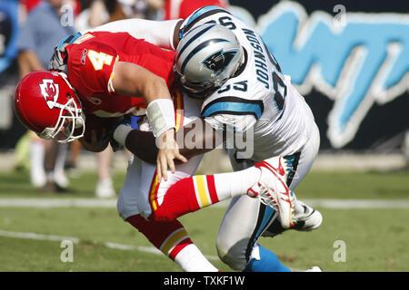 Carolina Panthers defensive end Charles Johnson (95) sacks Kansas City Chiefs quarterback Tyler Thigpen (4) for a 15-yard loss at Bank of America Stadium on October 5, 2008 in Charlotte, North Carolina.  The Panthers beat the Chiefs, 34-0.  (UPI Photo/Bob Carey) - Stock Photo