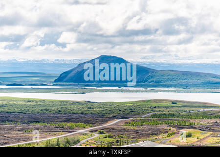 Reykjahlid, Iceland landscape high angle view of lake Myvatn during cloudy day with ring road highway - Stock Photo