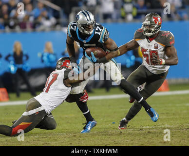 Carolina Panthers wide receiver Devin Funchess, center, runs after a catch for a first  down as Tampa Bay Buccaneers  defenders try to make a tackle in the second half of an NFL football game at Bank of America Stadium in Charlotte, North Carolina on January 3, 2016. Carolina won 38-10.   UPI/Nell Redmond . - Stock Photo