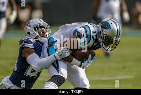 Carolina Panthers wide receiver Devin Funchess,  right, fights for yards as he is tackled  by Dallas Cowboys cornerback Chidobe Awuzie in the first half of an NFL football game in Charlotte, North Carolina on September 9, 2018. Photo by Nell Redmond/UPI. - Stock Photo