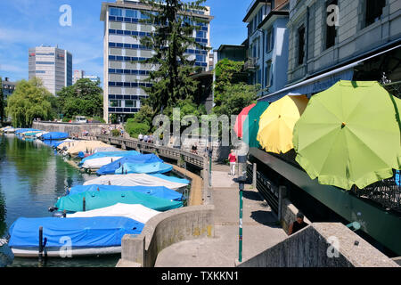 Schanzengraben promenade with covered boats and colourful parasols of Cafe Bar Le Raymond Bar, Zurich. - Stock Photo