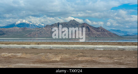 The Great Salt Lake and Mountains Snow Peaks on a cloudy day - Stock Photo