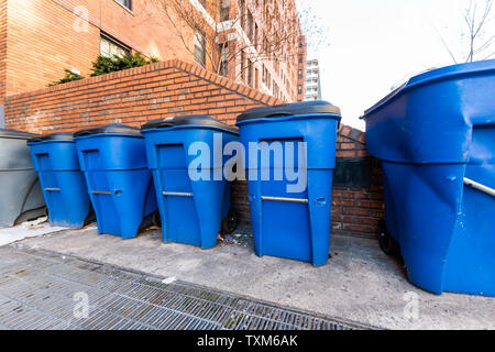 Washington DC, USA blue trash bins by residential apartment building in downtown city - Stock Photo