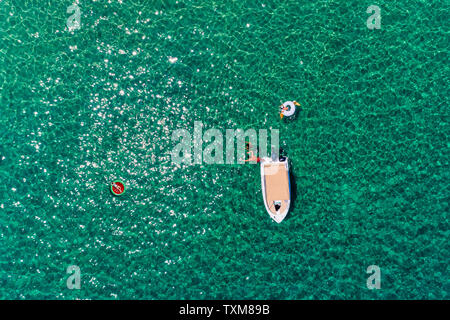 Top view of people in floats at the ocean at Chalkidiki, Greece. - Stock Photo