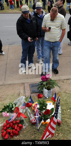 Visitors take photos of a memorial in Dealey Plaza on November 22, 2008 to commemorate the 45th anniversary of the assassination of U. S. President John F. Kennedy Dallas, TX.  Kennedy was shot on November 22, 1963 as he rode down Elm Street in Dallas.  The anniversary of his death brings history buffs, JFK fans and conspiracy theoryists back to the site.   (UPI Photo/Ian Halperin) - Stock Photo