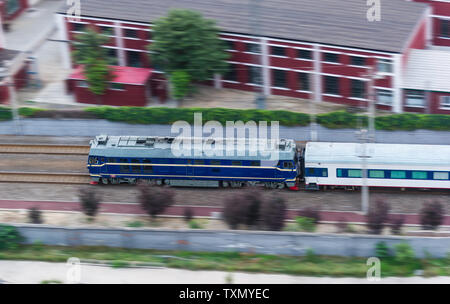 A high-speed internal combustion engine train on a railway. - Stock Photo