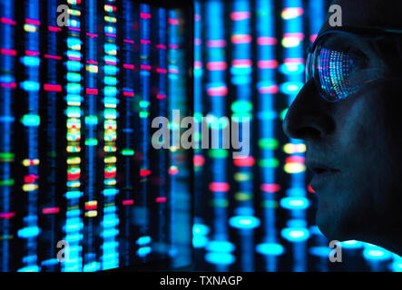 Genetic Research, scientist viewing DNA information on screens