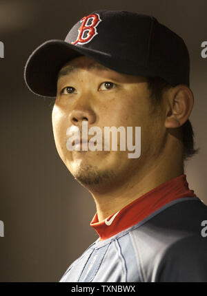 Boston Red Sox pitcher Daisuke Matsuzaka watches as the Red Sox go ahead of the Colorado Rockies during an interleague game at Coors Field on June 23, 2010 in Denver.  Matsuzaka will pitch in the last game of the three game series and try to prevent a Rockies sweep.  Colorado came from behind to beat Boston 8-6.               UPI/Gary C. Caskey - Stock Photo