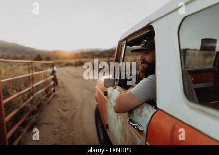 Man in off road vehicle on landscape of Kennedy Meadows, California, US - Stock Photo
