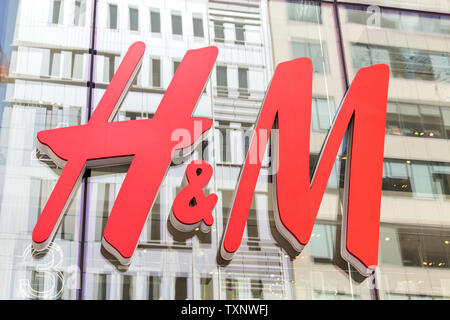 NEW YORK - CIRCA MARCH 2016: close up shot of H and M logo. H and M Hennes and Mauritz AB is a Swedish multinational retail-clothing company, known - Stock Photo