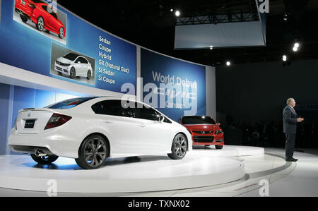 John Mendel, Vice-President American Honda Motor Company, introduces the 2012 Civic concept car at the 2011 North American International Auto Show at the Cobo Center in Detroit, January 10, 2011. UPI Photo/Mark Cowan - Stock Photo