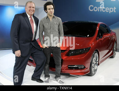 John Mendel, Vice-President American Honda Motor Company, left, and Fall Out Boy's Pete Wentz introduce the 2012 Civic concept car at the 2011 North American International Auto Show at the Cobo Center in Detroit, January 10, 2011. UPI Photo/Mark Cowan - Stock Photo