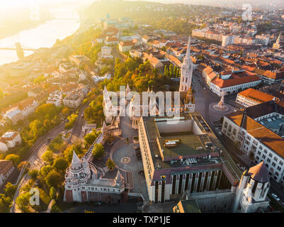 Aerial view of Fishermans Bastion and Matthias Church from above in Budapest during sunrise in autumn with dramatic sky (Budapest, Hungary, Europe)