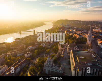 Aerial view of Fishermans Bastion and Matthias Church from above in Budapest during sunrise with Danube and Chain Bridge (Budapest, Hungary, Europe) - Stock Photo