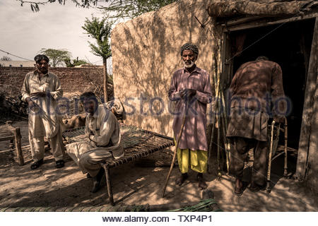 Father and brothers of Christin Asia Bibi, who was sentenced to death for blasphemy but emigrated to Canada, live completely impoverished near Lahore Pakistan. The family of Asia Bibi is also threatened with death and now lives hidden in a small village. - Stock Photo