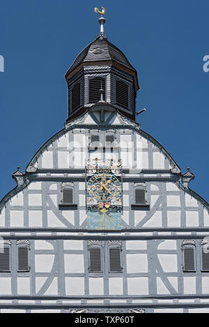 historic town hall clock at the market square in the old town of butzbach germany - Stock Photo