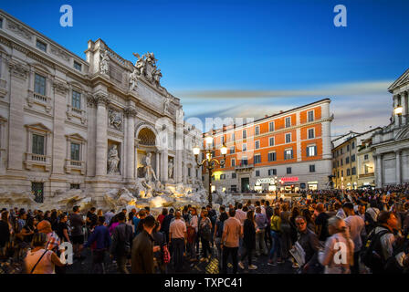 Rome, Italy - September 30 2018: Tourists crowd around the Trevi Fountain at sunset in the historic center of Rome, Italy. - Stock Photo