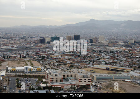 Both El Paso, Texas and Juarez, Mexico can be seen from the mountains in northern El Paso, Texas on January 10, 2019.. The sister cities have been separated by a border fence for a decade, but the Trump administration is proposed replacing the current fence with a stronger metal barrier. Construction on a 4-mile barrier to replace a chain link fence just west of the Paso del Norte bridge began in September.  Photo by Natalie Krebs/UPI - Stock Photo