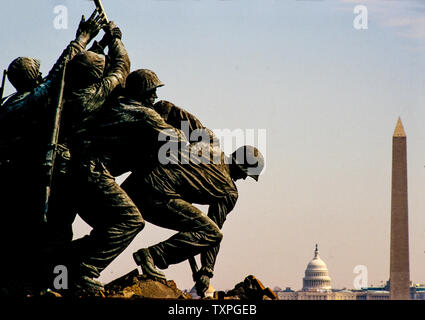 The United States Marine Corps War Memorial (Iwo Jima Memorial) is a national memorial located in Arlington County, Virginia, in the United States. Dedicated in 1954,[1] it is located in Arlington Ridge Park with George Washington Memorial Parkway,[2] near the Ord-Weitzel Gate to Arlington National Cemetery and the Netherlands Carillon. The war memorial is dedicated to all U.S. Marine Corps personnel who died in the defense of the United States since 1775.  The memorial was inspired by the iconic 1945 photograph of six Marines raising a U.S. flag atop Mount Suribachi during the Battle of Iwo J